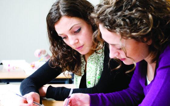 2 Women Paperwork